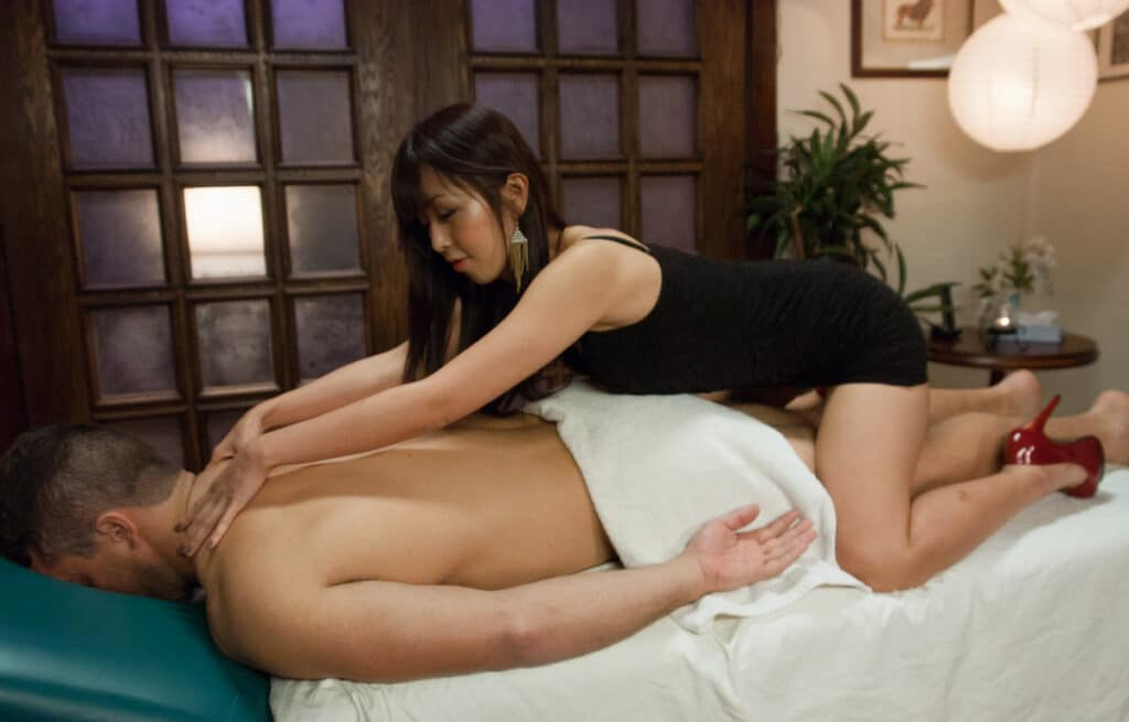 asian cowgirl riding while massaging